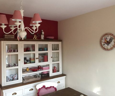 Matching style chandelier and wall clock